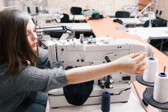 Alone seamstress overworking at garment factory Royalty Free Stock Image