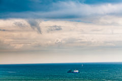 Alone ship in blue sea Stock Images