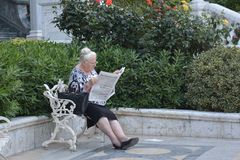 Alone sitting woman on a bench Royalty Free Stock Photos