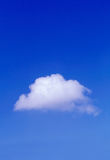 Alone in the sky. Fluffy white cloud Royalty Free Stock Photo