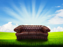 Alone sofa on grass field and blue sky Royalty Free Stock Photography