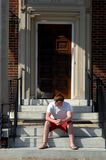 Alone on steps of dorm Royalty Free Stock Photography