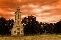 Alone in the storm. Old abandoned church at the end of a village Royalty Free Stock Photo