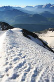 Alone on the summit ridge. Like a bird on the top of the mountain with an impressive point of view. Ridge with snow Royalty Free Stock Photos