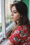 Alone thoughtful sadness girl. Is sad at the window Royalty Free Stock Photo