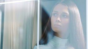 Alone thoughtful sadness women standing near the window.  stock footage