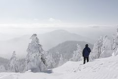 Alone tourist with a backpack. In the high mountains in winter time. Travel concept royalty free stock photos