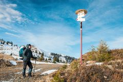 Alone tourist with a backpack. In the high mountains in winter time. Travel concept Stock Photography