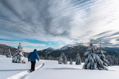 Alone tourist in the high mountains in winter time Stock Image