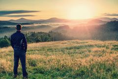 Alone tourist on hill look at nice morning land stock images