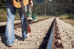 Alone traveler barefoot walk on the railway Stock Photography
