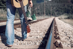 Alone traveler barefoot walk on the railway Royalty Free Stock Images