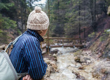 Alone traveler in spring mountain forest Stock Image