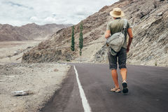 Alone traveler walks on the mountain road in indian Himalaya mou Stock Images