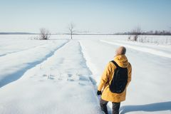 Alone traveler in yellow jacket Royalty Free Stock Photos