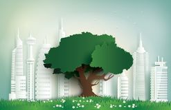 Alone tree on the field in city. Royalty Free Stock Image