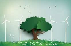 Alone tree on the field with wind mill. Stock Images