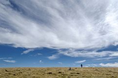 Alone under the clouds in Parang. Crossing a giant plateau, mountaineer traveling Stock Photo