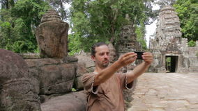 Alone visitor takes own picture in preah khan temple, angkor Stock Photo