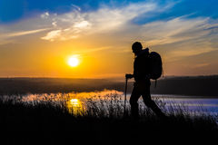 Alone walker and uprising sun Royalty Free Stock Image
