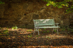Alone white bench in autumnal park Royalty Free Stock Images