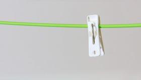 Alone white clothespin. On clothes hanger Stock Photos