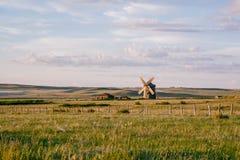 Alone windmill in desolate field stock photo