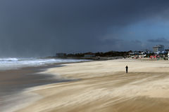 Alone in a windy beach taking a picture Royalty Free Stock Images