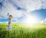 Alone Woman with blue sky in green fields Stock Photos