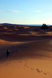 Alone woman in the dunes. Alone woman in the Sahara desert Stock Photo