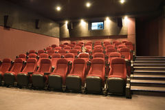 Alone woman in the movie theatre Stock Photos