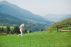 Alone woman walking on a meadow -Thoughtful stock image