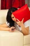 Alone woman watch horror movie at tv Royalty Free Stock Photo