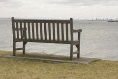 Alone Wood Bench and view to the Sea Landscape Australia Melbourne nice. Alone Wood Bench and view to the Sea Landscape Australia Melbourne royalty free stock photos