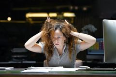 Alone working in office with a lot of documents. Yelling and screaming for bad results royalty free stock photography
