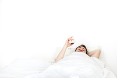 Alone young man in bed Stock Images