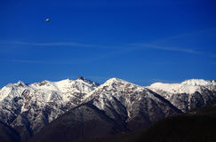 Alone zeppelin above Caucasus mountains Royalty Free Stock Photos