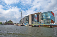 Along Amsterdam Channels. On a sunny day. Conservatoire of Amsterdam Stock Photography