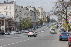Along the avenue Budennovsky moving cars and pedestrians Royalty Free Stock Images
