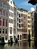 Along the Canal. Colorful row of houses along a canal in Amsterdam royalty free stock image