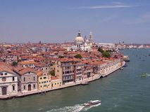Along the grand Canal Venice. Scenic view of the buildings and boats along the grand canal in Venice Italy Royalty Free Stock Images