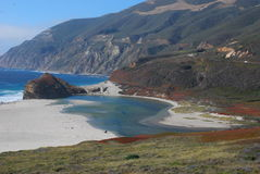 Along Highway One. Beautiful sandy beaches, and rocky shores along California's Highway One coast highway. Wildflowers blanket the rocks and cliffs Stock Photos