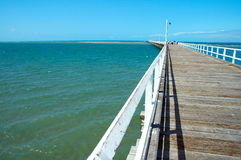 Along the Jetty. Looking along the length of the Pier in Queensland, Australia Royalty Free Stock Photo