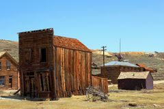Old Cart and Windswept Building in Bodie Ghost Town, California royalty free stock image