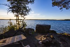 A peaceful picnic spot. Along one of Sweden`s lake, this place is amazing for chilling an watching the sun go down stock photo