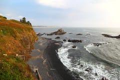 Along the Oregon Coast: Yaquina Head Cobble Beach. Along the Oregon Coast: Yaquina Head Area of Outstanding Natural Beauty with the black cobble beach royalty free stock photo