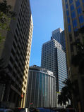 Along Paseo de Roxas and Ayala Ave. The 2 buildings on the left are old while the 3 on the right are new ones. The center portion of the photo resembles a royalty free stock images