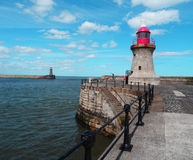 Along the pier to the lighthouse Royalty Free Stock Image
