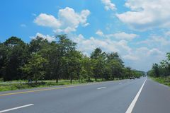 Along the road to the blue sky. Along the long road to the blue sky with many clouds royalty free stock photography