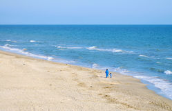 Along the shore. Mammy and daughter are walking along the shore Stock Photography